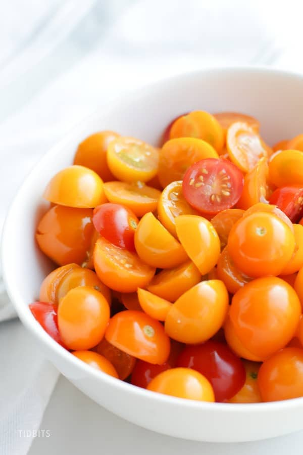 A bowl of halved cherry tomatoes