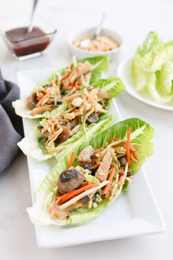 Pressure Cooker Easy Moo Shu Pork served on lettuce wraps with dipping sauce