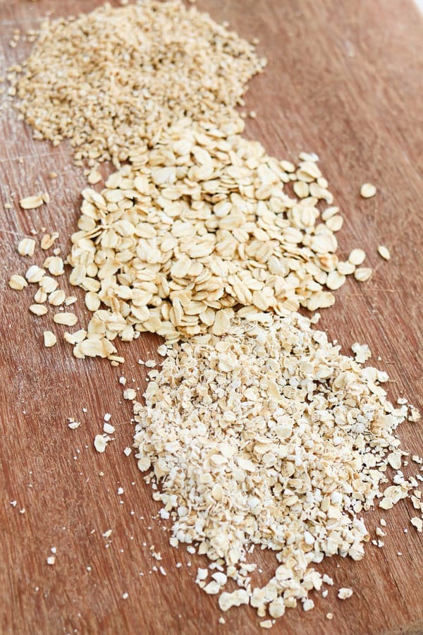 Three kinds of oats on a wooden worksurface