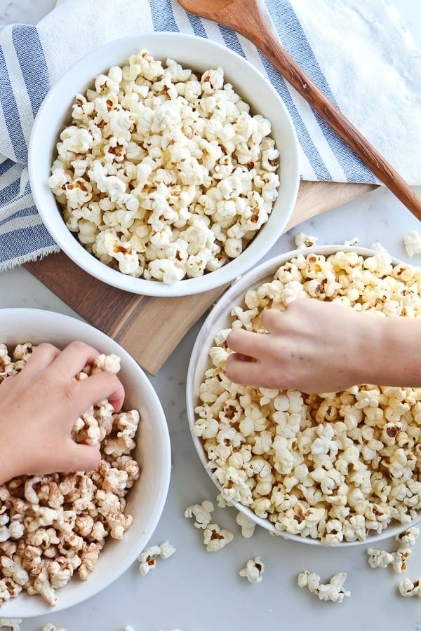 Instant Pot Popcorn in 3 white bowls