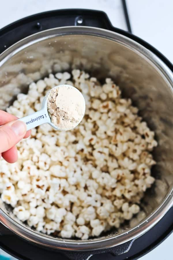 Instant Pot Popcorn in a silver pot