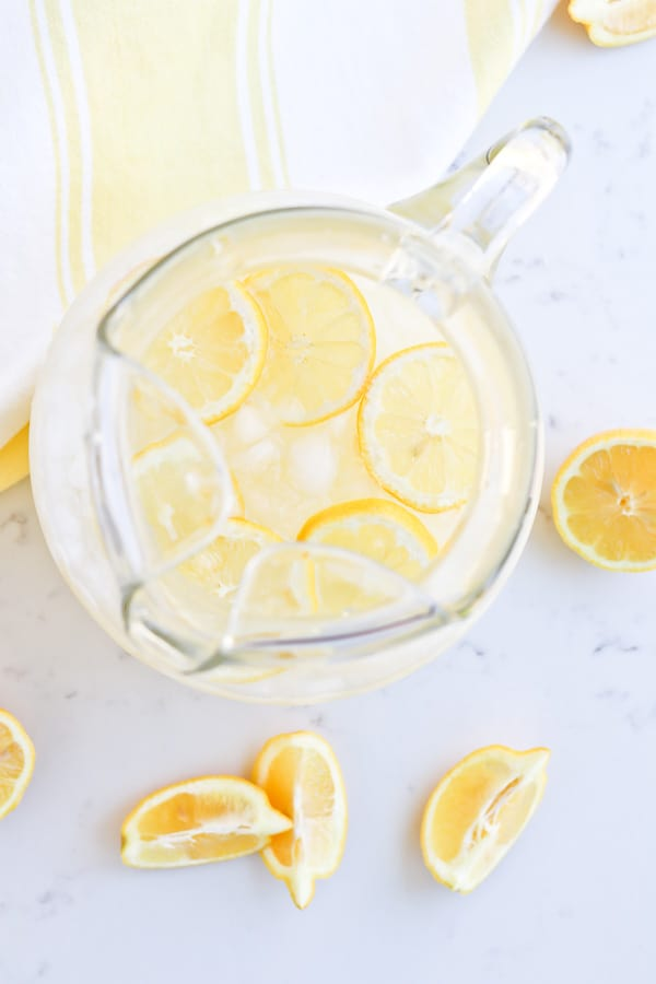 Instant Pot Lemonade in a pitcher with ice and lemon slices