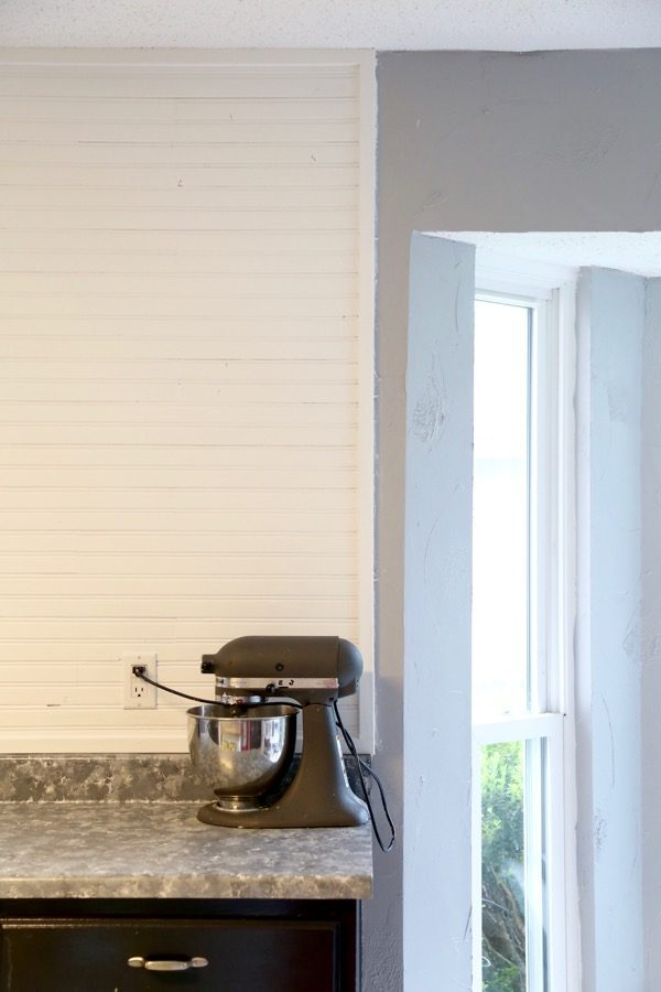 Closeup image of beadboard backsplash in kitchen