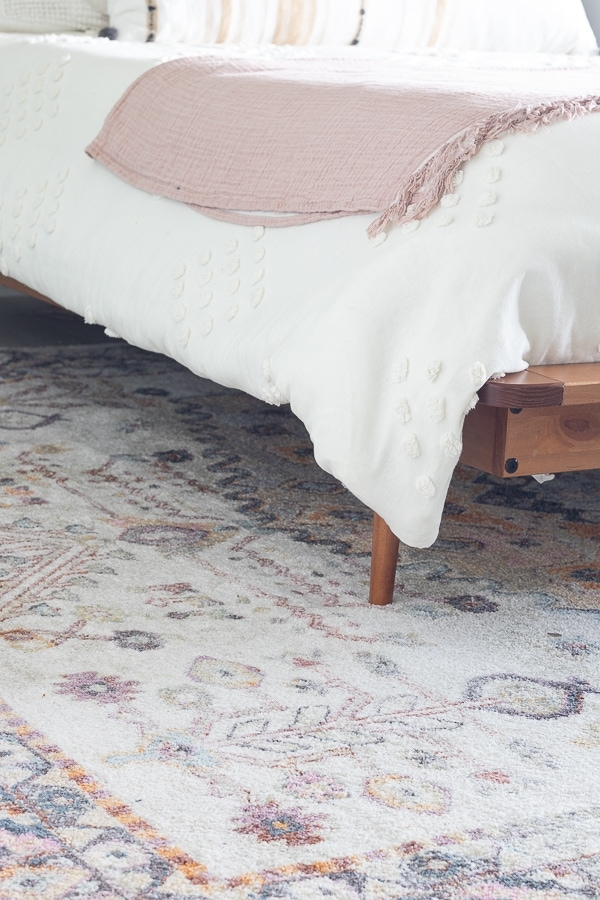 transitional rug in pinks and greens