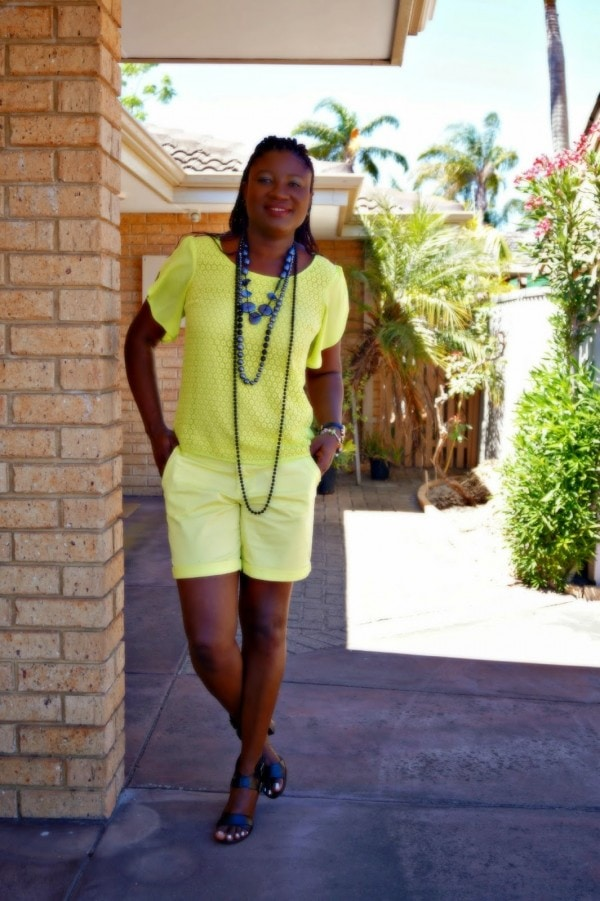 Yellow Top Shorts Black Statement Necklaces | 40plusstyle.com
