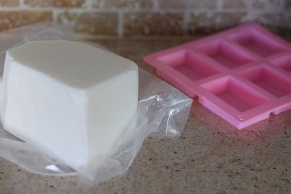 block of goat milk soap base and pink soap mold