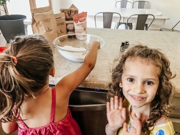 girls helping make natural laundry detergent