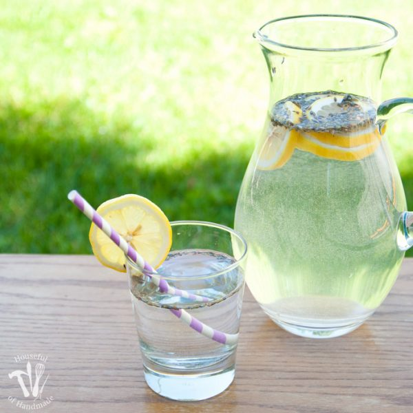 Turn your lemon water into something extra special. This lavender lemon water recipe is the perfect refreshment for a hot afternoon, Sunday brunch, or rustic wedding. | Housefulofhandmade.com