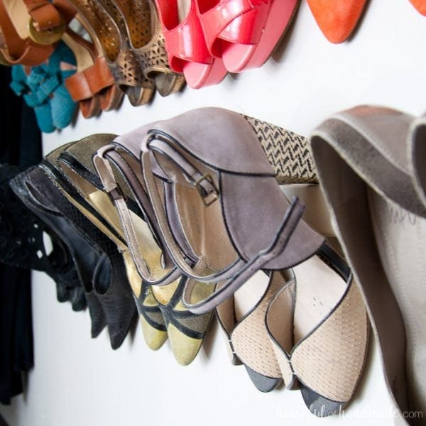Shoes as art in the walk in closet! Create shoe storage with only $1. Housefulofhandmade.com