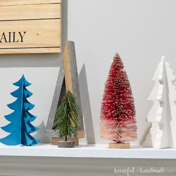 I love all these Christmas trees. They are the perfect Christmas tree farm holiday mantel. Housefulofhandmade.com