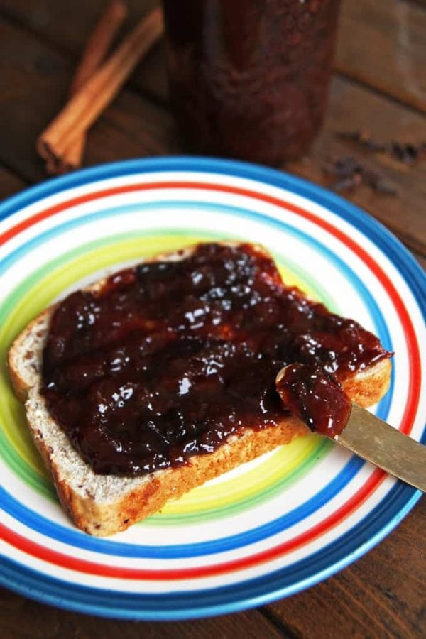 Spreading Plum Butter on Bread