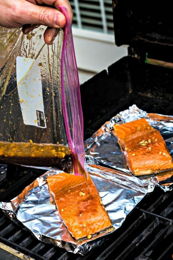 Grill salmon in aluminum foil boats with marinade
