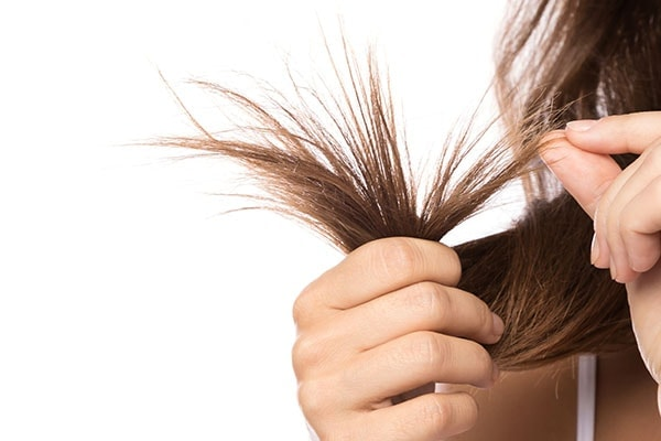 Not cutting split ends is a hair mistakes that can affect hair growth