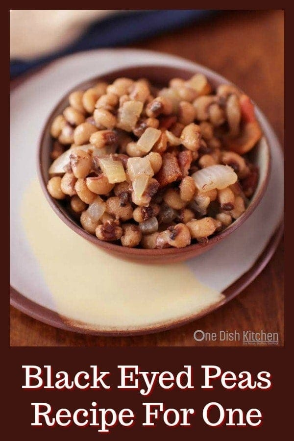 This Southern Black Eyed Peas recipe is a New Year's Day tradition. Ready in minutes, these black eyed peas are seasoned with bacon, onions, and garlic. Bring good luck into your new year with this incredibly delicious single serving recipe! | One Dish Kitchen | #blackeyedpeas #newyear #newyearsrecipe #hoppinjohn #bacon #singleserving #sidedish #cookingforone #recipe