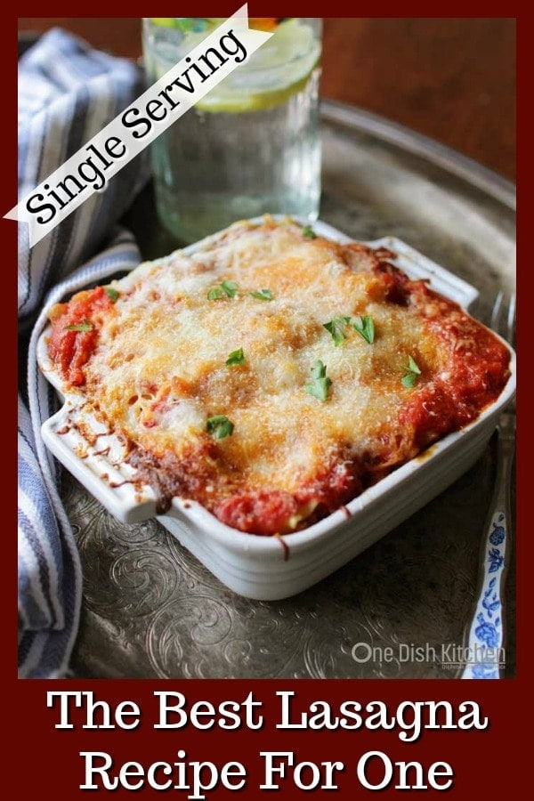 A classic recipe for the best homemade lasagna! This mini lasagna is made with just 2 lasagna noodles and layered with meat, cheese, and sauce. Baked in a small baking dish, this lasagna is the perfect amount to serve one or two people. | One Dish Kitchen | #singleserving #lasagna #lasagnaforone #lasagne #recipeforone #cookingforone