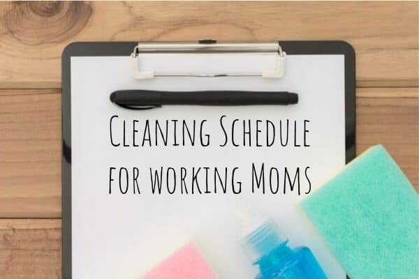 Cleaning Schedule Checklist for working moms on a clipboard