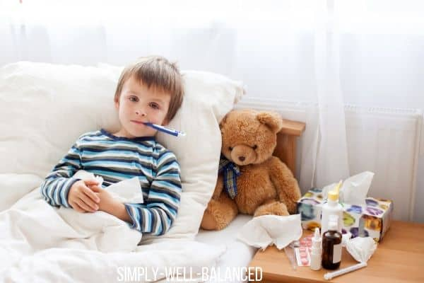 Child sick in bed with the flu