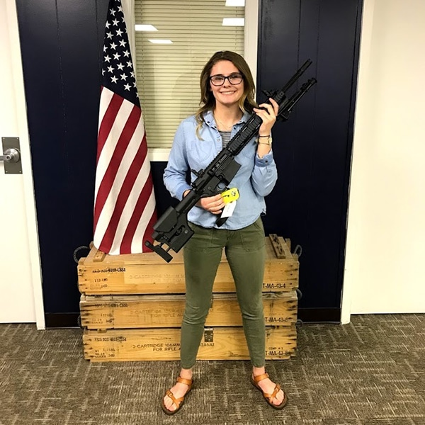 woman with rifle for webinar giveaway