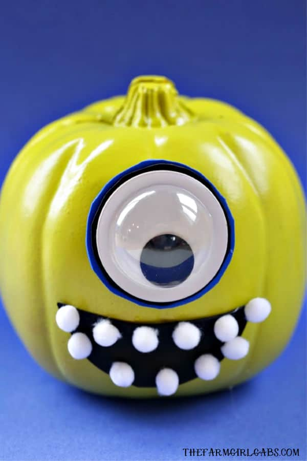 Add a little scare to your Halloween with this easy DIY No-Carve Mike Wazowski Pumpkin. This craft is perfect for a very Disney Halloween. #DisneyCraft #Pixar #MonstersInc #WaltDisneyWorld #DisneyCraft #Pumpkin #HalloweenDecor
