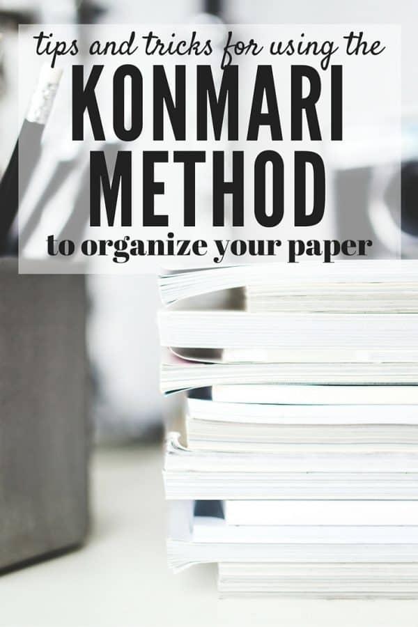 Stack of papers with text overlay - Tips and Tricks for using the Konmari Method to Organize Your Paper