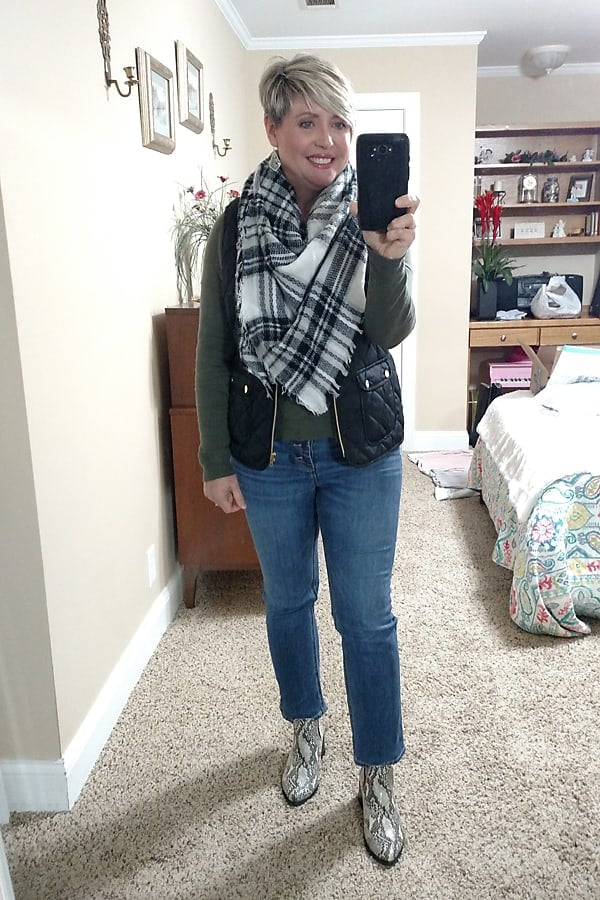 black quilted vest with jeans, sweater and plaid scarf