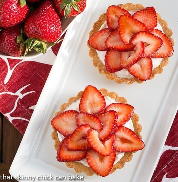 Fresh Strawberry Tartlets on white platter