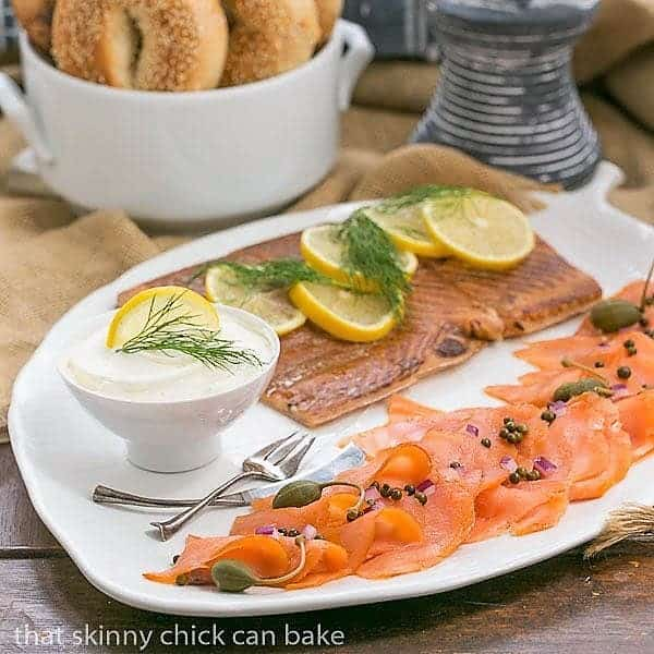 A Smoked Salmon Platter on a white, leaf shaped ceramic tray
