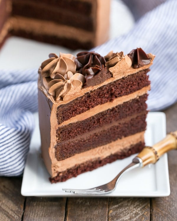 Chocolate Fudge Layer Cake  slice on a square white plate