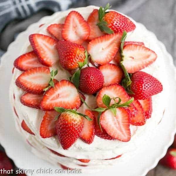 Fresh Strawberry Meringue Cake from above on a white cake stand