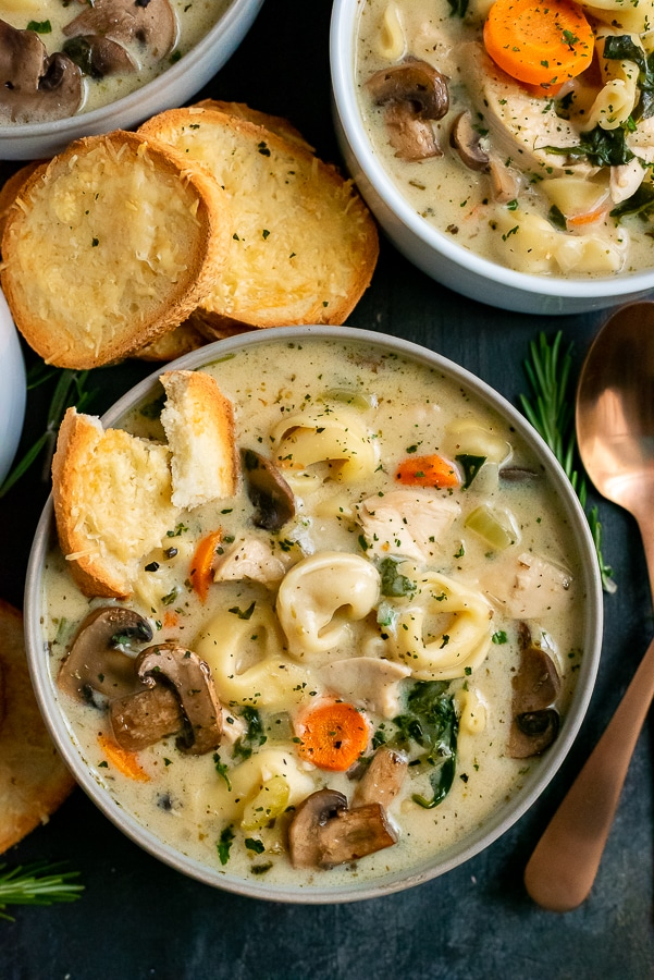 Bowls filled with soup. Served with toasted bread.