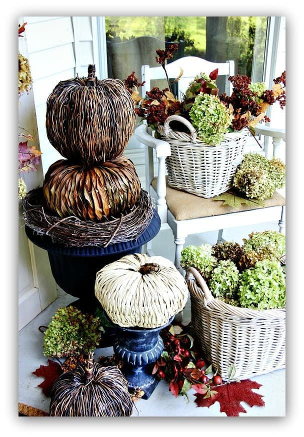 The greenery and pumpkin decorations are perfect for fall.