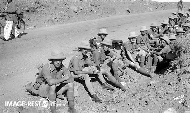 British troops take a roadside rest stop on the way to Razmak