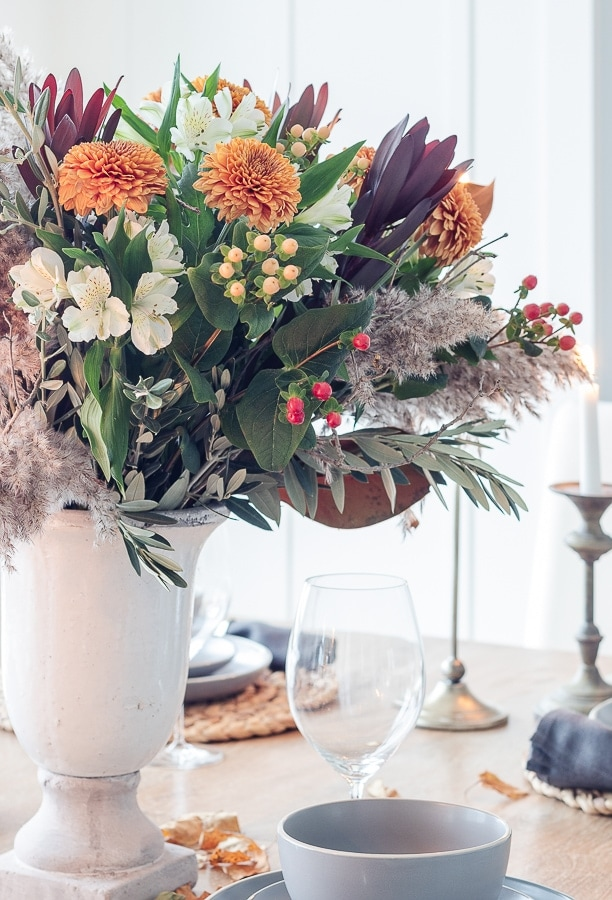 wine glasses gray dishes warm tones fall flowers