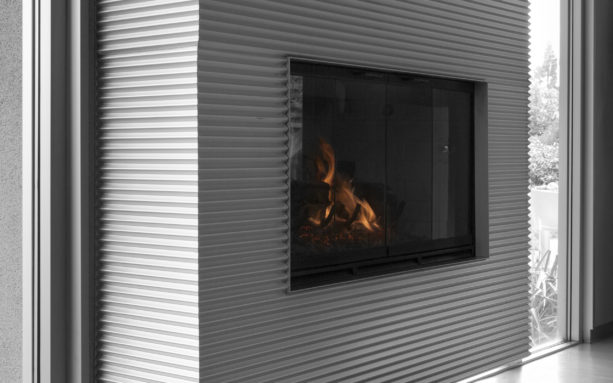 the use of corrugated metal panels as fireplace wall surround