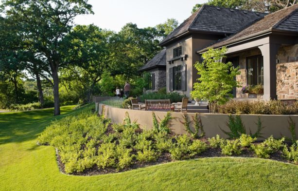 low stucco retaining wall in steep grass slopes