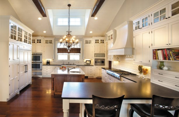 vintage look in a traditional kitchen with a slight of contemporary style from white cabinets and black wood countertops