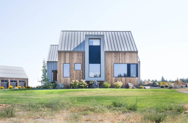 modern aesthetic house with color combination of zinc gray metal roof and vertical cedar siding