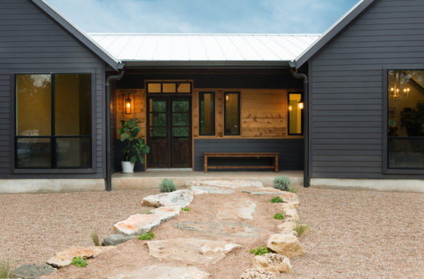 beautiful one-story ranch style cottage in a grey-colored vinyl siding