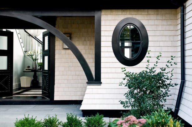 an ivory white wall shingles with black trim in a modern-Victorian entry