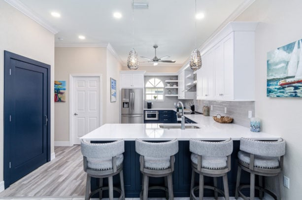 blue and white kitchen in u-shaped layout and a peninsula