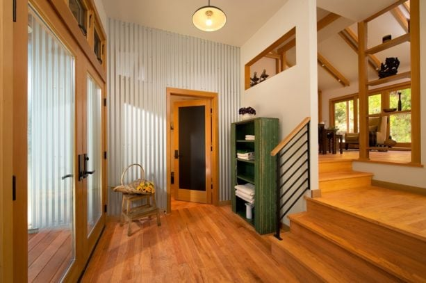 a modern entry with corrugated metal accent wall