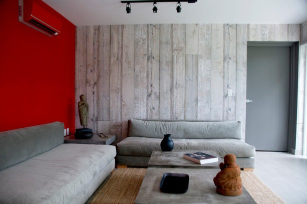 stunning and bold red and grey wall design in a contemporary living room