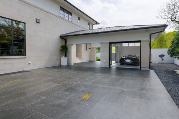 elegant carport idea with tile flooring in front of a contemporary garage