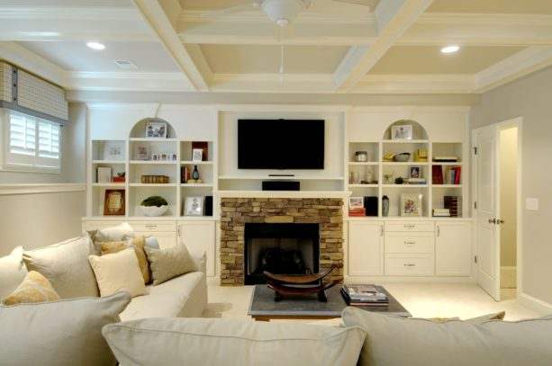 polished white wall unit with stone standard fireplace