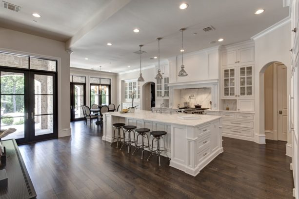 a traditional kitchen with white trim and ebony-stained white oak floor
