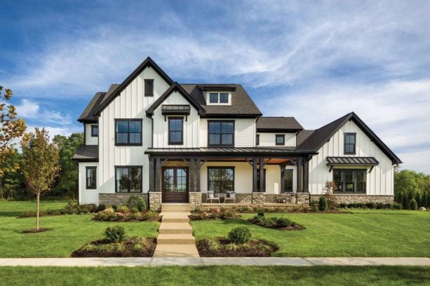 cream white exterior with brown roof and black trim