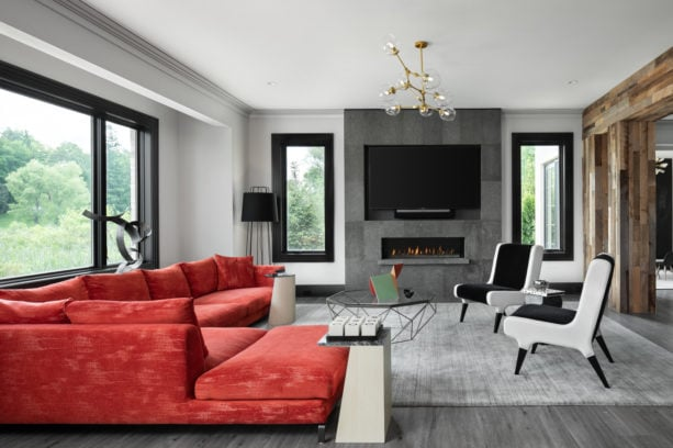 a grey transitional living room with stunning red sectional