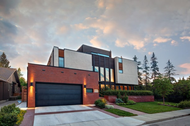a safe combination of red brick garage and black door