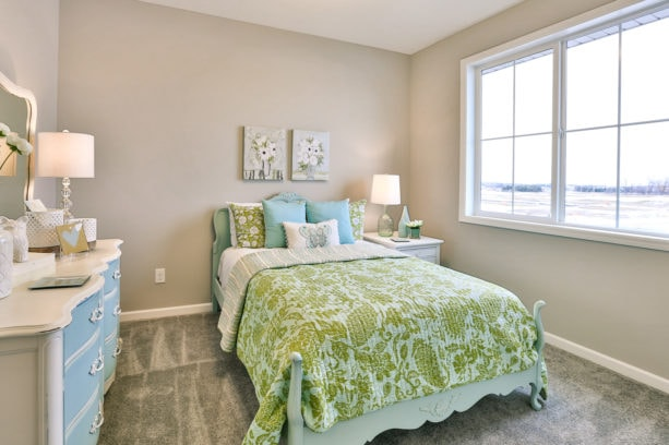 a girl's bedroom with the combination of lime green, mid gray, and sapphire blue colors