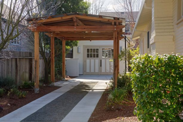 traditional carport idea in front of a vintage garage